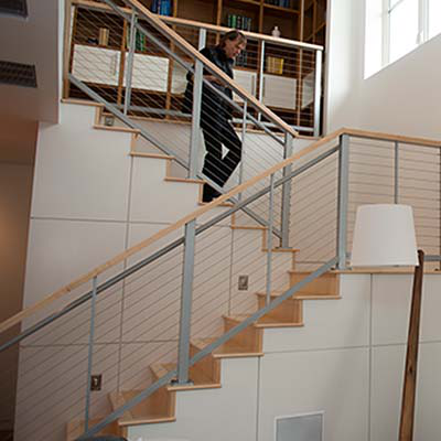 Man walking down stairs in a new home