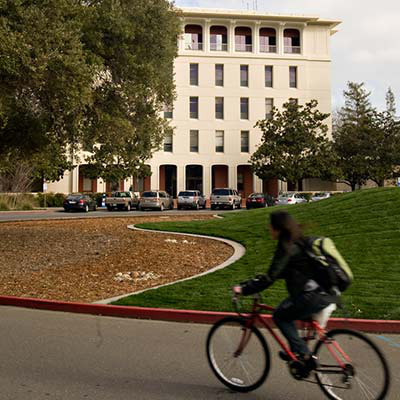 Bicyclist on Mrak Hall Drive heading to Mrak Hall