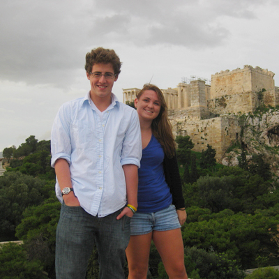 Two students pose in front of the parthenon in Greece